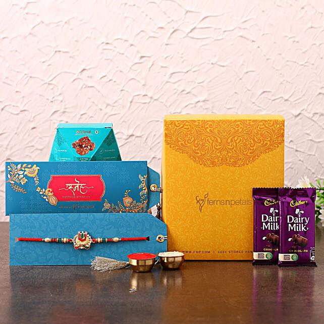 Devotional Rakhi With Chocolates and Chana Burfi:Raksha Bandhan Combo Gifts