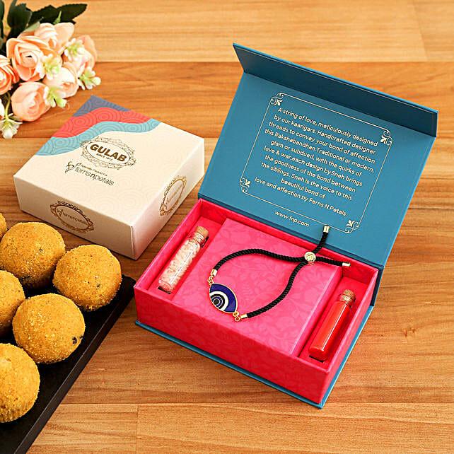 Evil Eye Lumba Rakhi And Besan Laddoo Box:Rakhi with Sweets