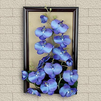 Frame with artificial blue flowers