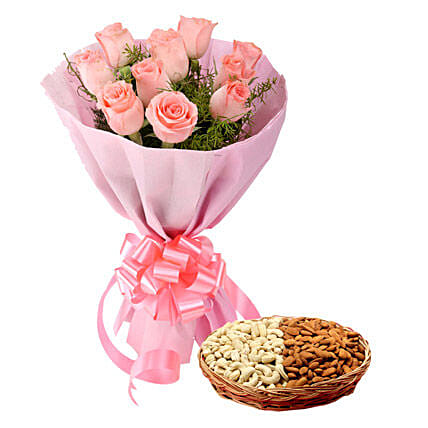 Gift hamper of pink roses bouquet and dry fruits