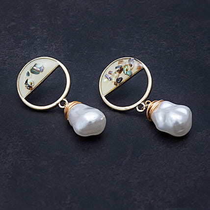 gold toned circular shaped earrings