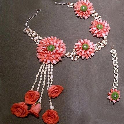 A set of floral necklace and mang tikka with orange roses, green daisy, and mogra:Flower Jewellery