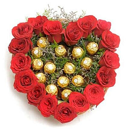 Heart Shape Love - Heart shape arrangement of 17 Red Roses with 16 Pieces Ferrero rocher.:Flowers N Chocolates - anniversary