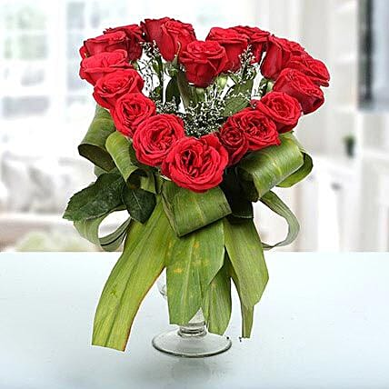 Red rose arrangement in samadhan vase:Heart Shaped Flowers