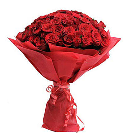Hot Red - Bunch of 100 red roses in red paper packing.