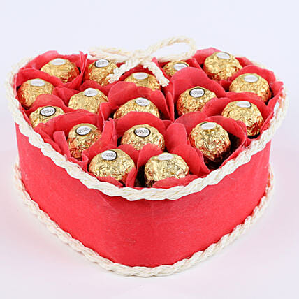 Gift set of ferrero rocher chocolates and artificial rose petals chocolates:First Anniversary Gift