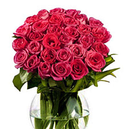 Love in the air - 30 pink roses are nicely arranged in a fish bowl glass vase.:Send Premium Roses