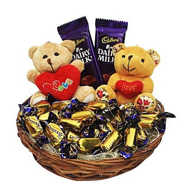 Love Rules Hamper-2 teddies holding heart key chains 2 inches,2 Dairy milk 17 grams,22 Cadbury Eclairs