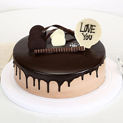 Online cream cake with love you topper
