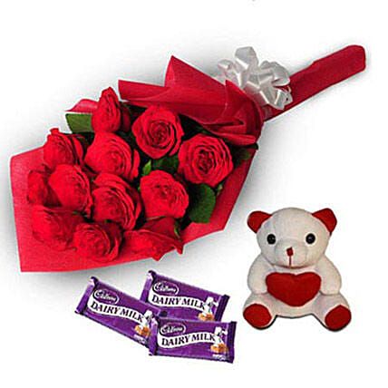Loving Hug - Bunch of 12 Red Roses in paper packing, 6 inch height  and 3 cadbury dairy milk chocolates of 38gms each.:Roses And Teddies