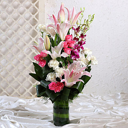 Mixed Flowers In Cylindrical Vase:Flower Delivery in Surendranagar