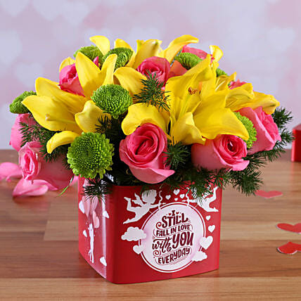 mix roses in  vase arrangement for valentine:Lilies for anniversary