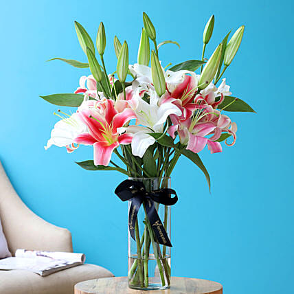 Mixed Oriental Lilies In Cylindrical Vase