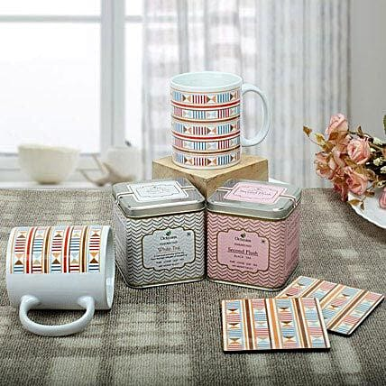 A gift hamper of printed ceramic white mugs and tea costers with two flavours of Octavius tea