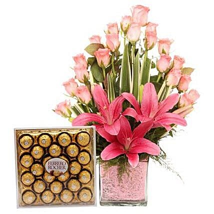 Pink Sweetness Reflected - Glass vase arrangement of 20 pink roses with 2 pink asiatic lilies and Ferrero Rocher chocolates.:Ferrero Rocher Chocolates