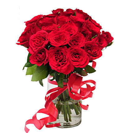 Pure delight - Glass vase arrangement of 24 red roses.
