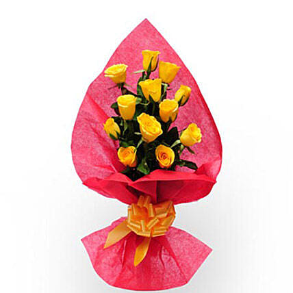 Pure Desire - One Sided Bunch of 12 Yellow Roses in a Pink Paper packing with Yellow Ribbon.