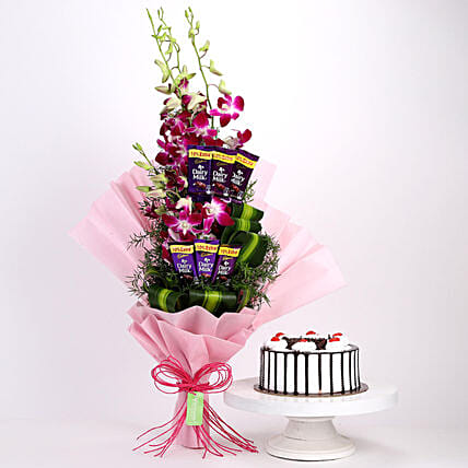 Online Dairy Milk Orchids Bouquet And Black Forest Cake:Cakes and Chocolates
