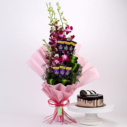Online Dairy Milk Orchids Bouquet And Chocolate Cake