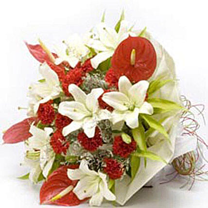 Queen of my heart - Bunch of 6 white lilies, 5 red anthuriums and 15 red carnations in white wrapping.