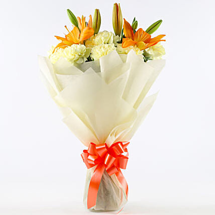 Radiance - Bunch of 10 yellow carnations 2 orange lilies in paper packing.