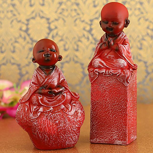 Red Praying Monk Idols On Rock