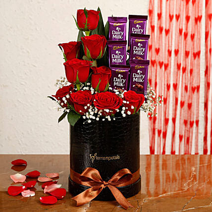 Red Roses Dairy Milk Arrangement In Round FNP Box