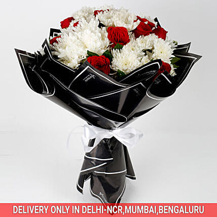 roses and chrysanthemums in black wrapping