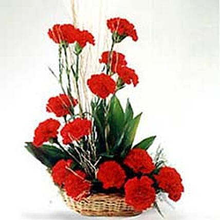Romantic Affair - Arrangement of 15 Red Carnations attractively set in a cane basket.:Carnations