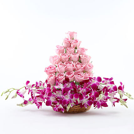 Cane Basket arrangement of 20 pink roses and 6 purple orchids womens day women day woman day women's day:Flowers For New Year