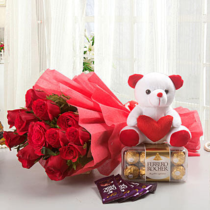Rosy Combo - Bunch of 12 Long Stem Fresh Red Roses with 5 Cadbury Dairy Milk chocolates 14gm each, 200gm Ferrero rocher chocolate box & Soft toy.