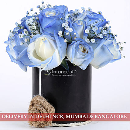 blue roses arrangement in black box