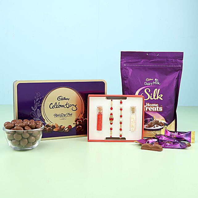 set of 2 rakhi for bro and bhabhi with cadbury surprise