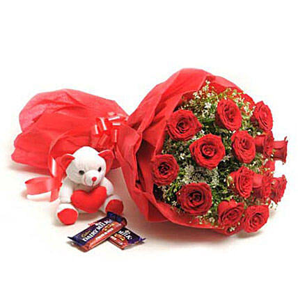 Soft N Nutty - Bunch of 15 Long Stem Red Roses in a paper packing with Two Fruit N Nut chocolates & Cute soft toy.
