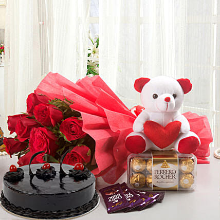 Some One Special - Bunch of 12 Red Roses with 5 cadbury chocolates, Soft toy, Ferrero Rocher and 500gm Chocolate Cake.:Send Cake with Teddy