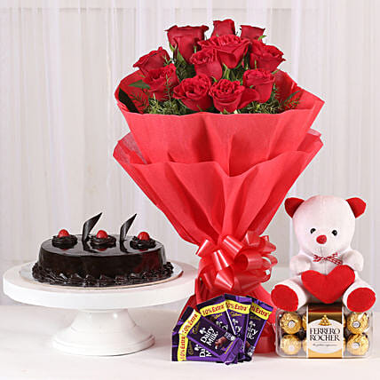 Some One Special - Bunch of 12 Red Roses with 5 cadbury chocolates, Soft toy, Ferrero Rocher and 500gm Chocolate Cake.:Cakes Combo
