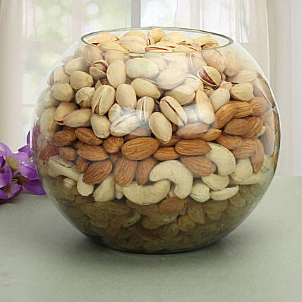 Glass vase filled with dry fruits