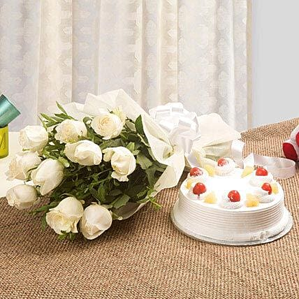 Sweet Heavenly Hamper - Bunch of 10 white roses in a paper packing and 500 grams of  cake.