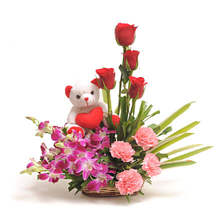 Sweet Inspiration - Basket arrangement of Orchids, carnations, roses & Cute Soft toy.