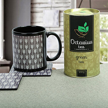 A gift set of ceramic black mug with a tea coaster containing same prints and octavius green tea