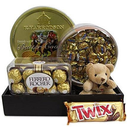 Twix Choco Hamper-A Nice hamper of assorted chocolates and cookies which includes,400gm butter cookies,butter Toffees,200gm Ferrero Rocher chocolate,58 gms Twix and 3 Inch long Soft toy