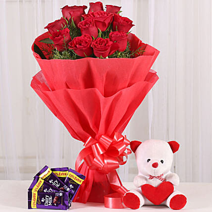 Cuddly Affair - bunch of 12 red roses with 6 inch teddy and 5 Cadbury Dairymilk .:Send Soft toys to Bhopal