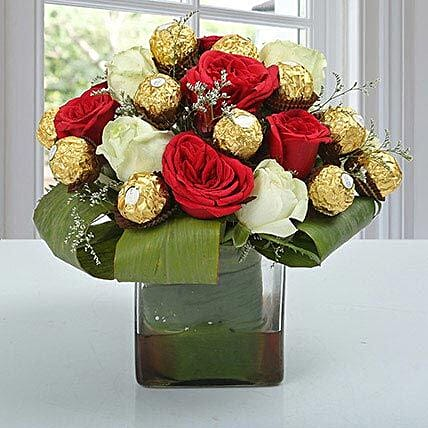 Glass vase arrangement of roses and ferrero rochers