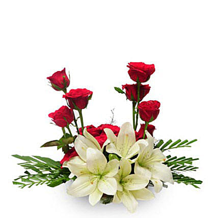 Elegance - Basket arrangement of 12 red roses and 6 lilies.