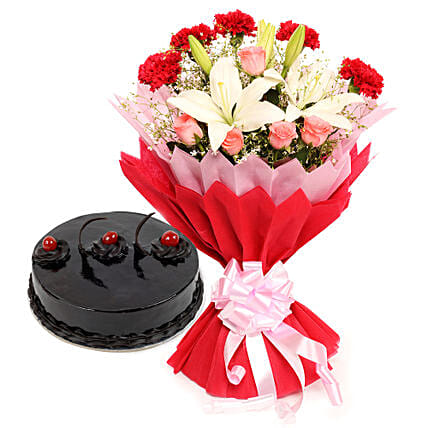 Enchanted Bloom - Bunch of 2  Asiatic Lilies, 5 Red Carnations and 5 Pink Roses in a two layer paper packing and half kg truffle gifts