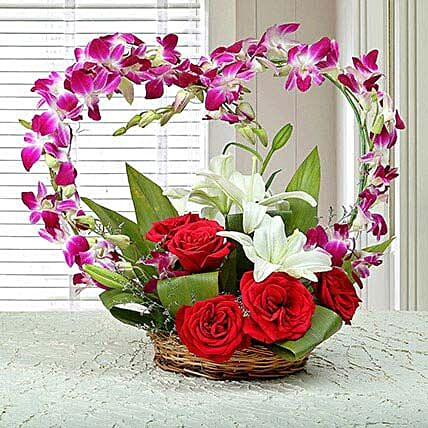 Red rose, purple orchid, white asiatic lily arrangement