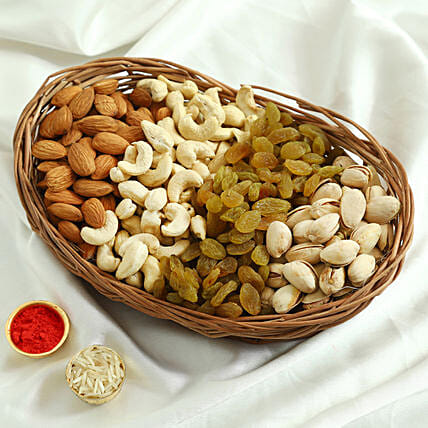 Basket of dry fruits with roli chawal