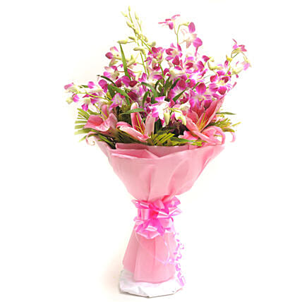 Perfection - Bunch of 10 Purple Orchids with 2 pink lilies in a paper packing.
