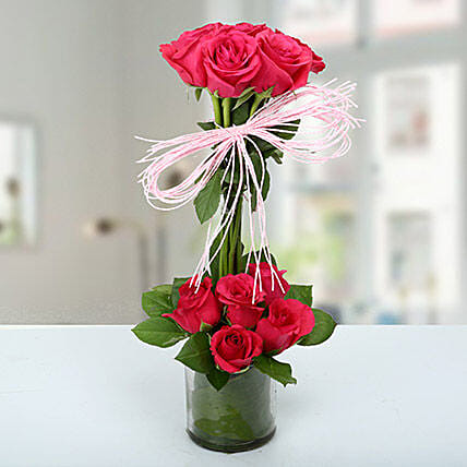 Dark pink rose  arrangement in glass vase