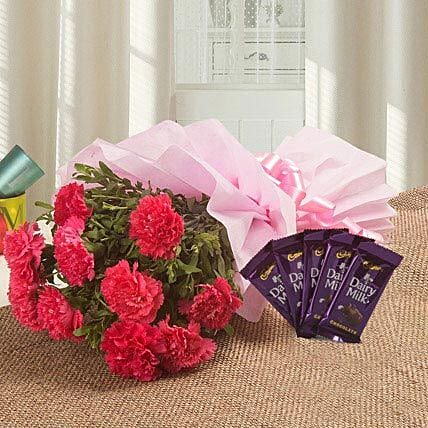 Spoil Rotten With Flowers N Flavours - Bunch of 10 pink carnations and 5 Dairymilk chocolates 13 grams each.